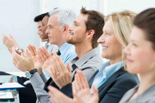 Businesspeople In A Row Greets With Clapping Hands